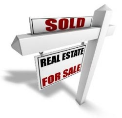 real estate for sale sign with sold sign on top